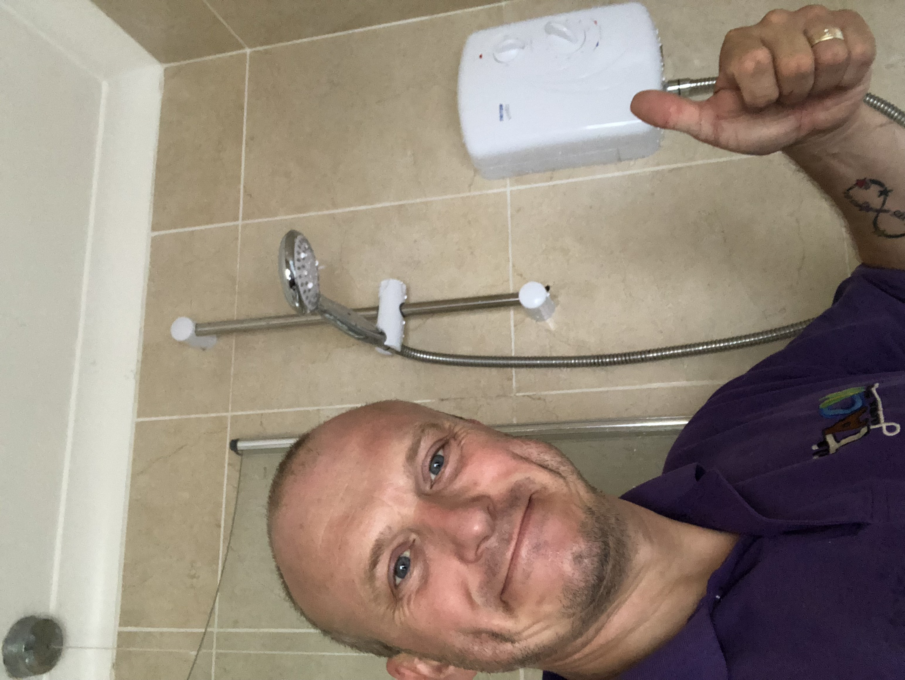 electrician changes shower loughton